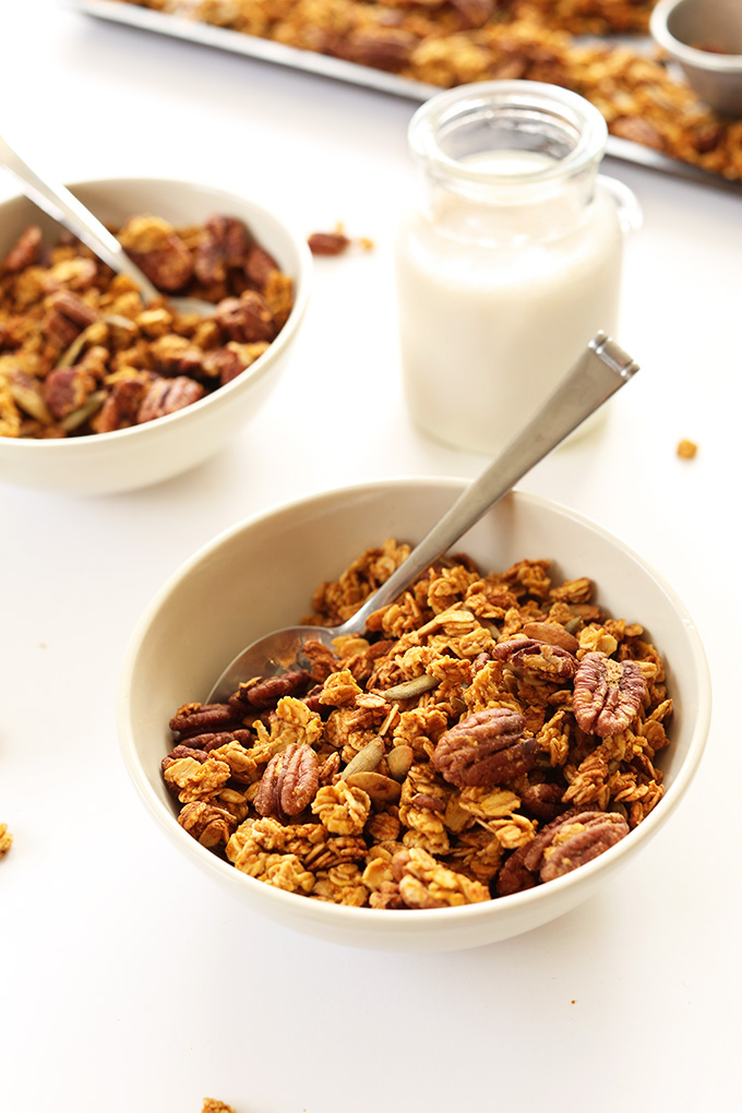 Bowls of Pumpkin Pecan Granola and a side of almond milk