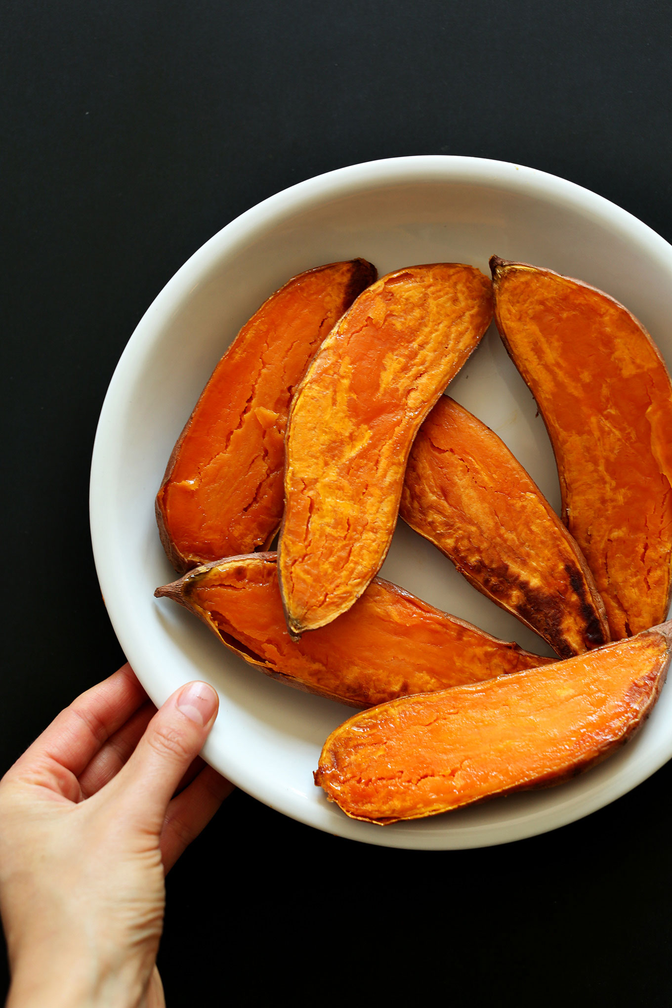 Big bowl of freshly roasted halved sweet potatoes