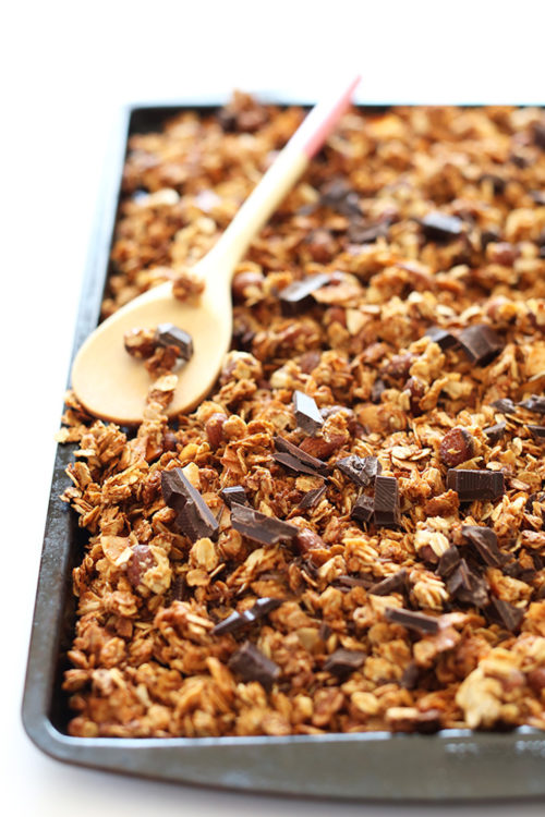 Baking sheet of Almond Joy Granola made with oats, almonds, coconut, and dark chocolate