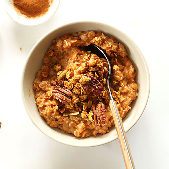 Bowl of Sweet Potato Pie Oats topped with pecans