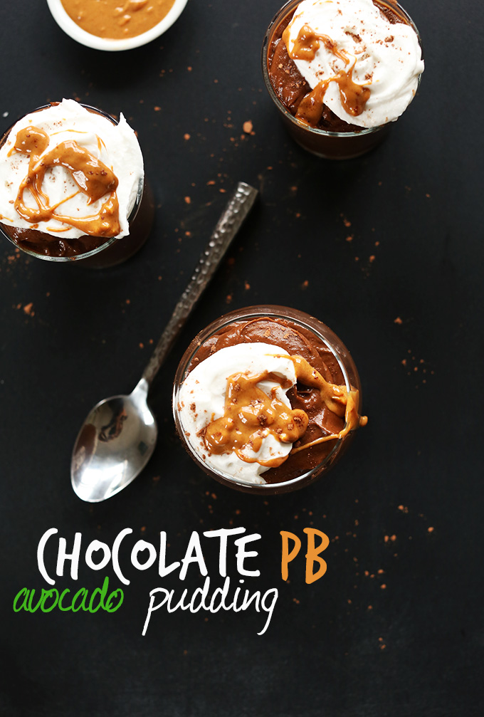Jars of thick and creamy Chocolate Avocado Pudding topped with coconut whip and peanut butter