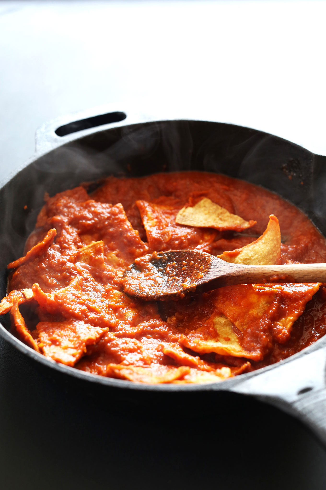 Making Tofu Chilaquiles in a cast-iron skillet