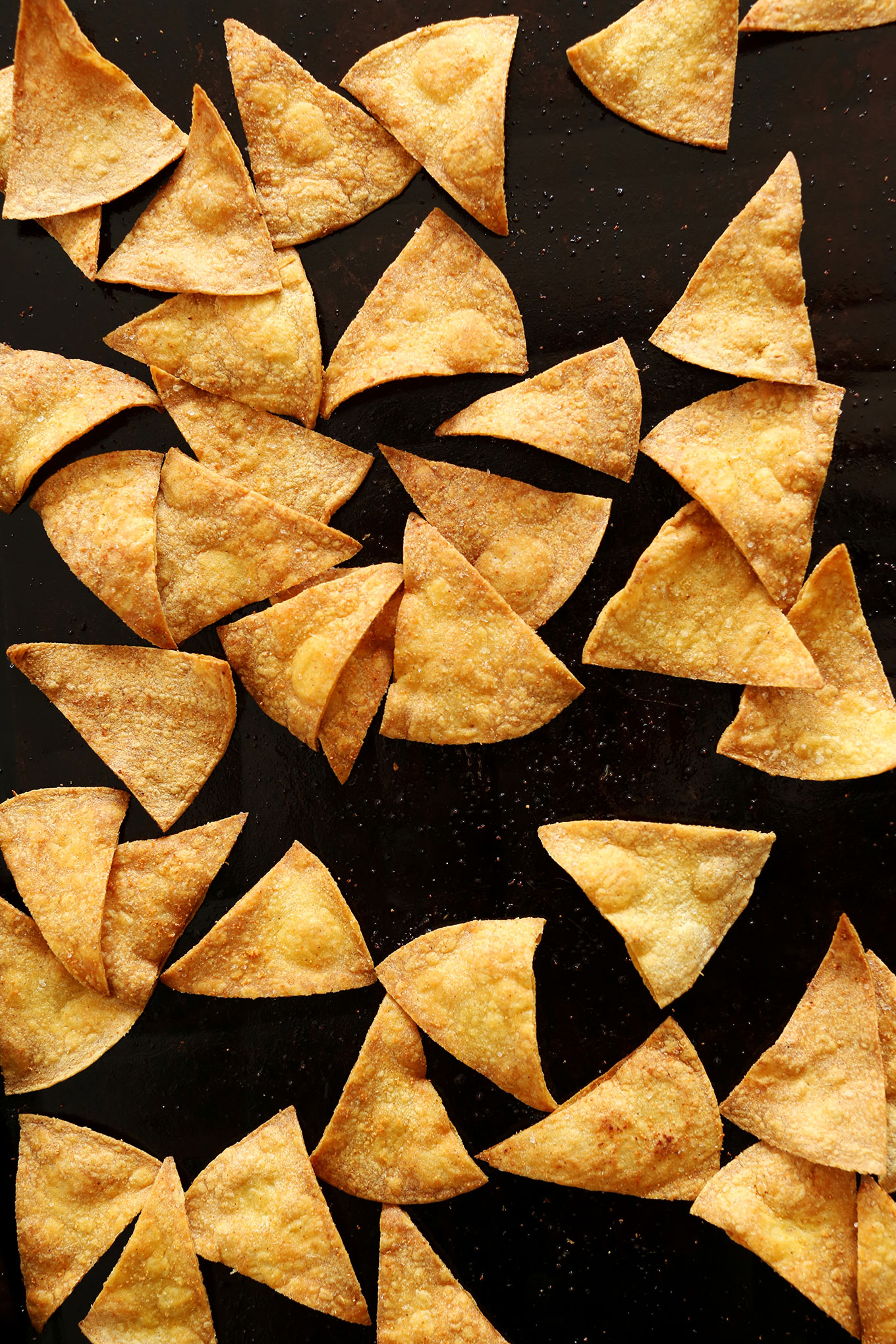 Baking sheet filled with homemade Baked Tortilla Chips