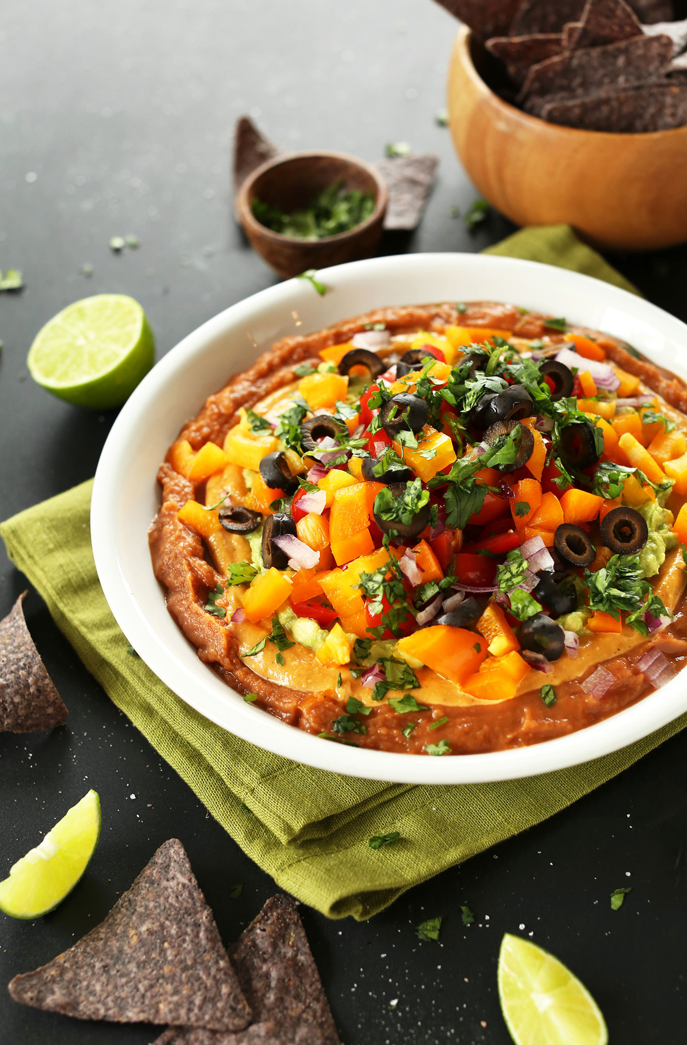 Bowl of our Mexican 7-Layer Dip loaded with vegetables for a healthy vegan snack