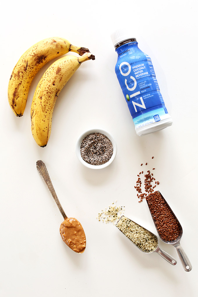 Coconut water and other ingredients for making a homemade chocolate coconut water drink