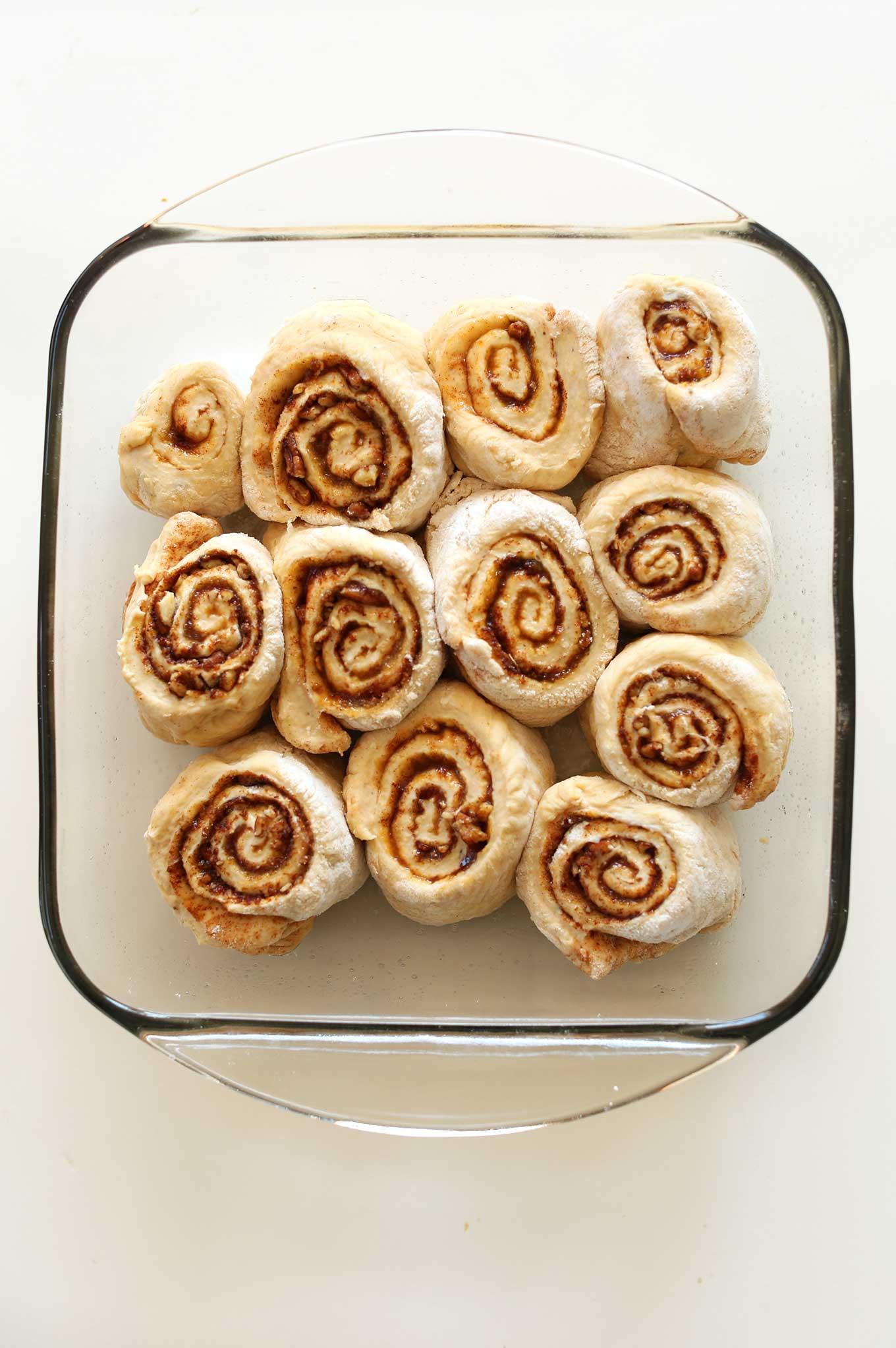 Baking pan filled with ready-to-bake Vegan Pumpkin Cinnamon Rolls