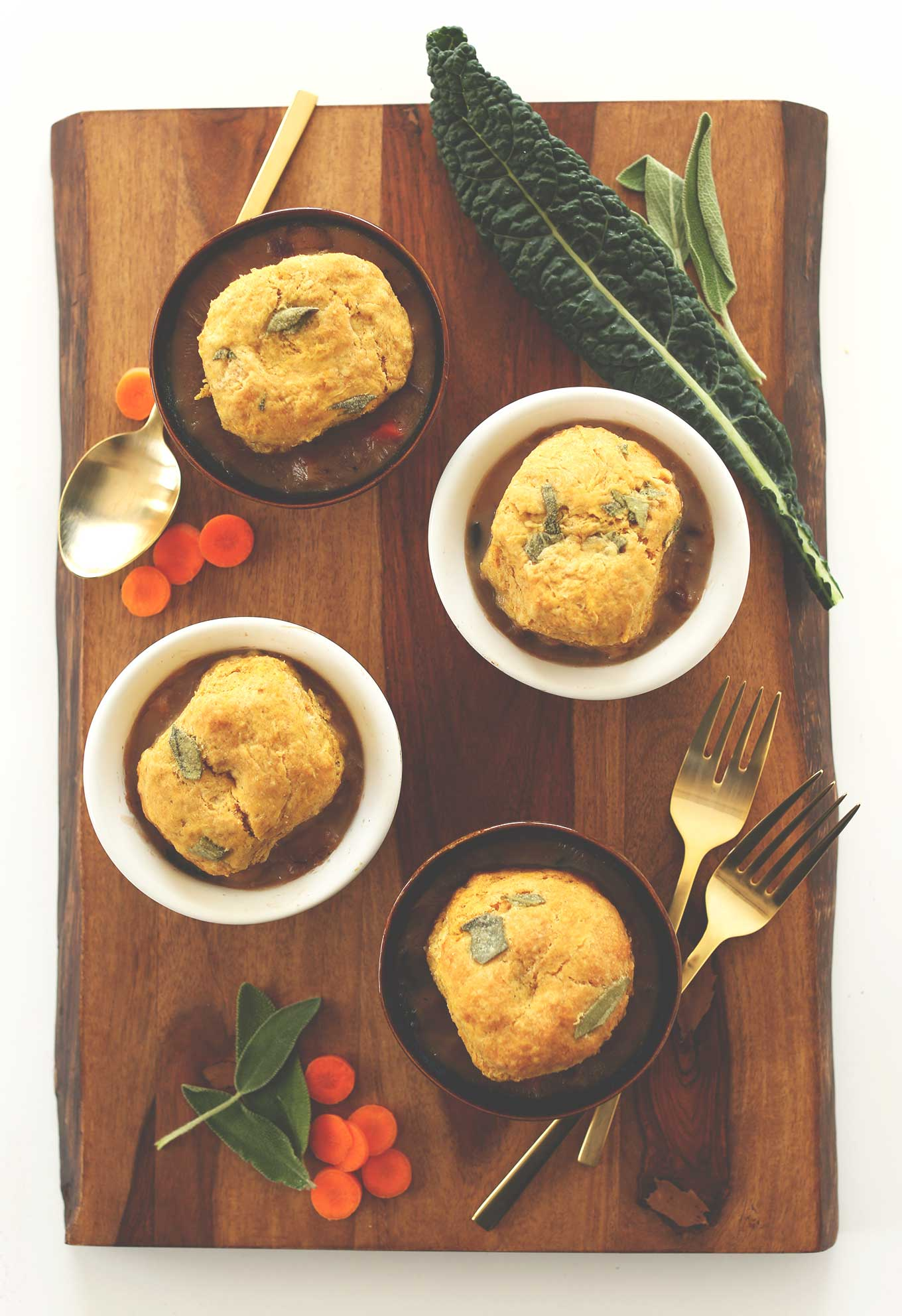 Small bowls of our Vegan Fall Pot Pies topped with Pumpkin Sage Biscuits