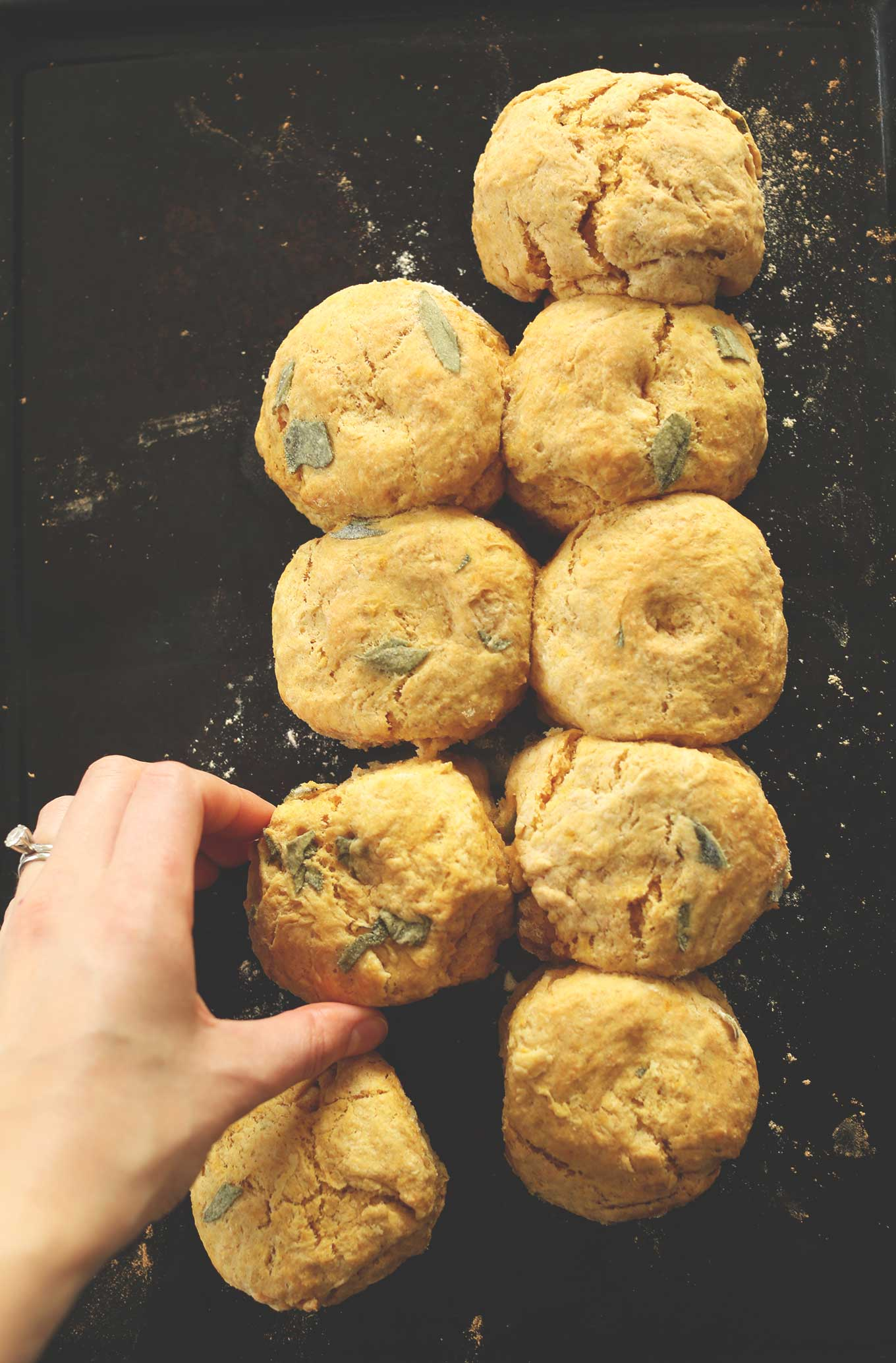 Grabbing one of our Pumpkin Sage Biscuits from the baking sheet