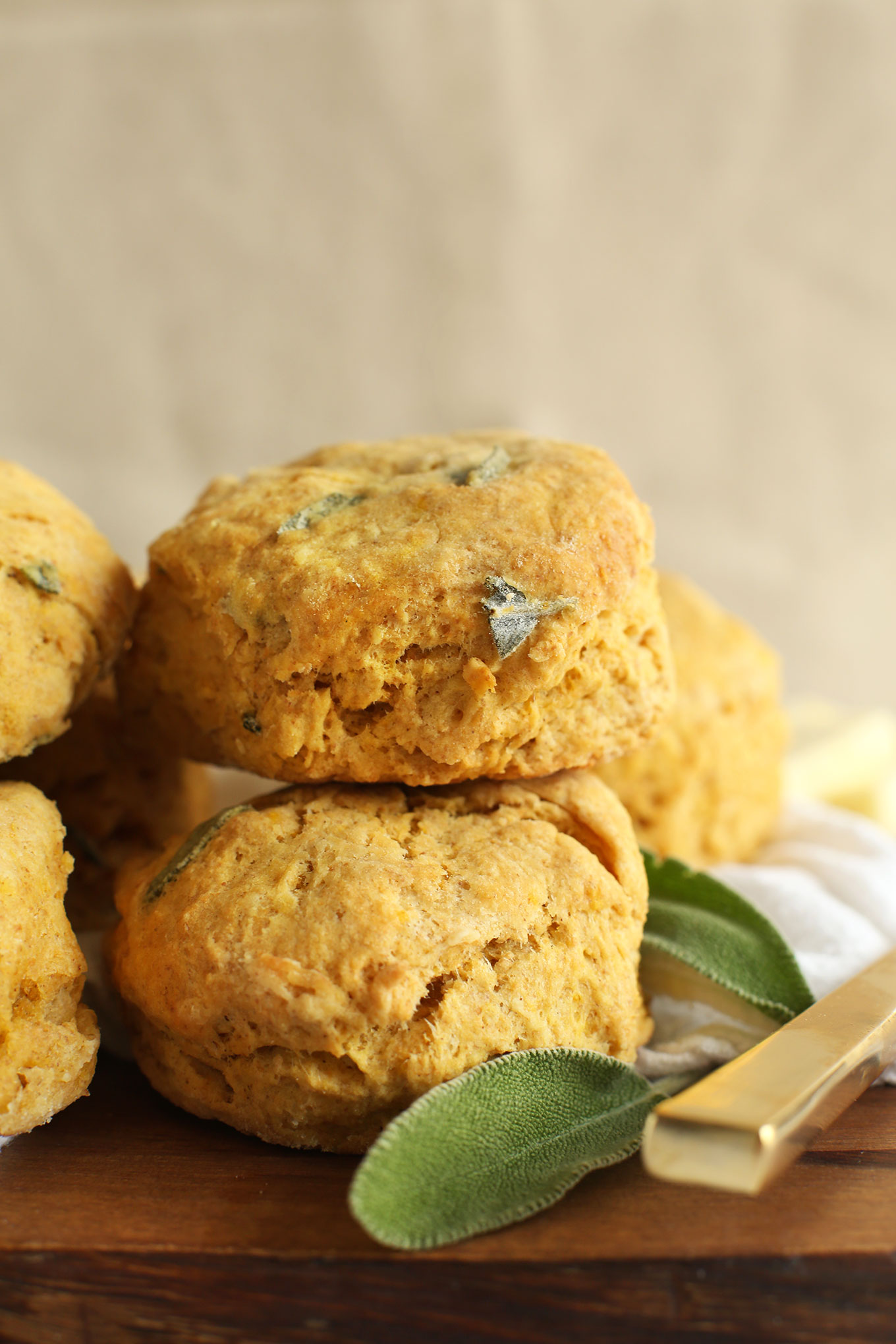 Pile of fluffy Pumpkin Sage Biscuits on a cutting board