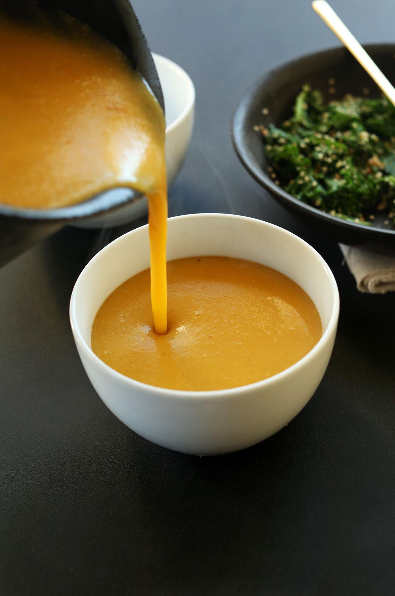 Pouring gluten-free vegan Pumpkin Soup into a bowl