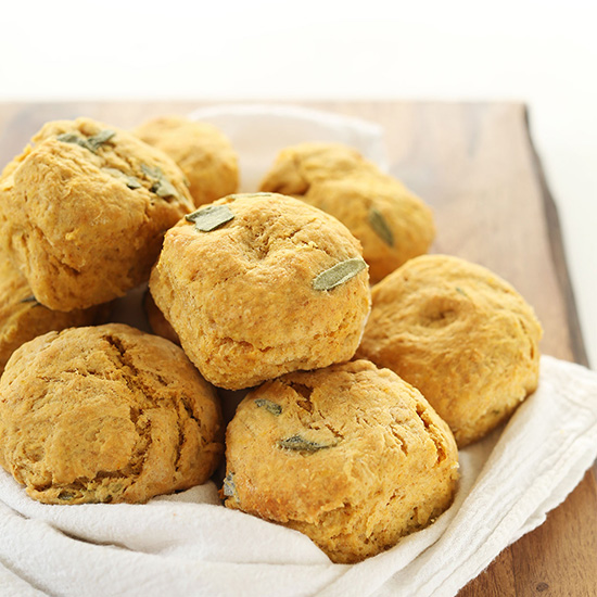 Batch of Pumpkin Sage Biscuits on a white towel on a cutting board