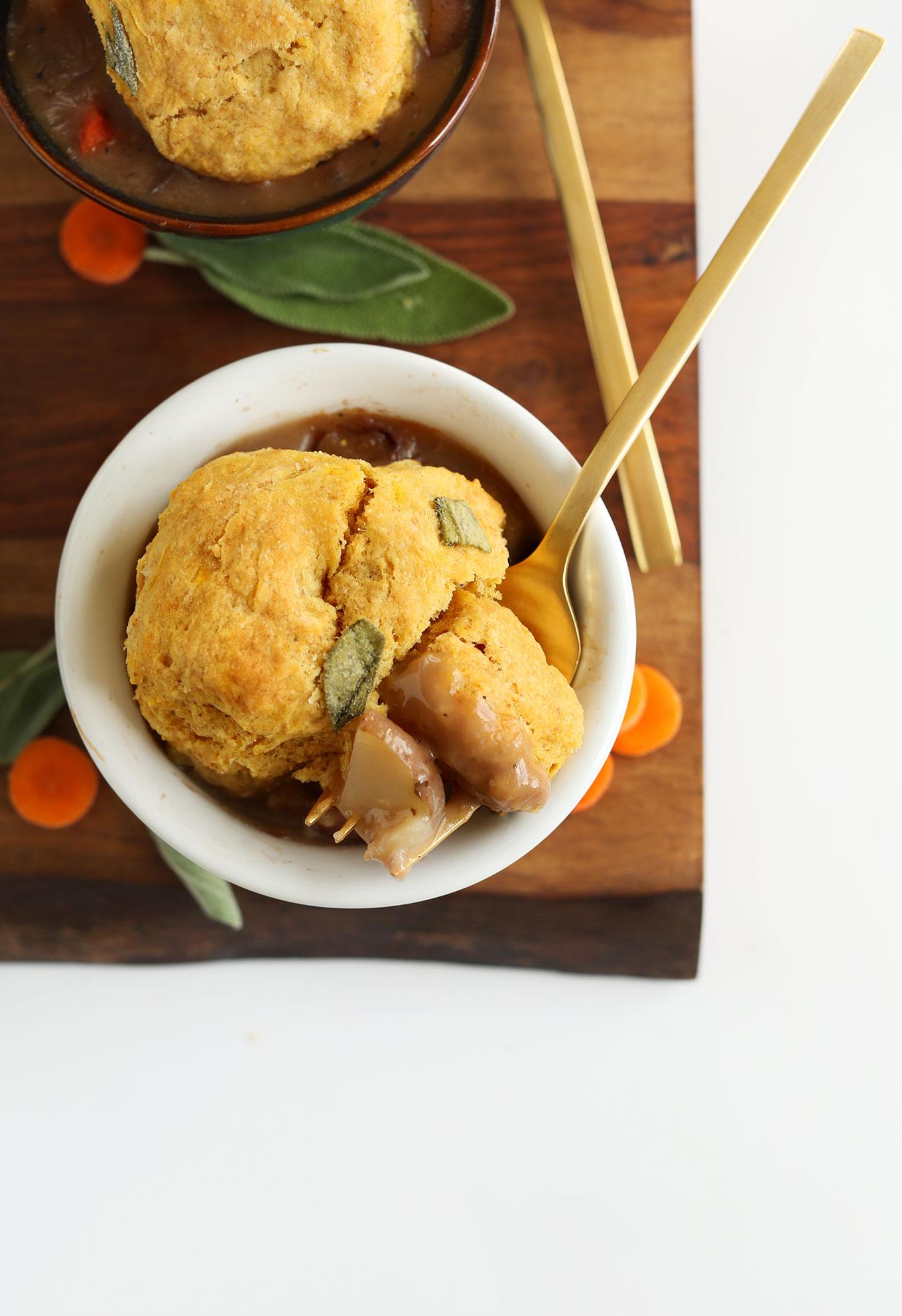Fork holding a bite of Fall Pot Pie for a vegan dinner
