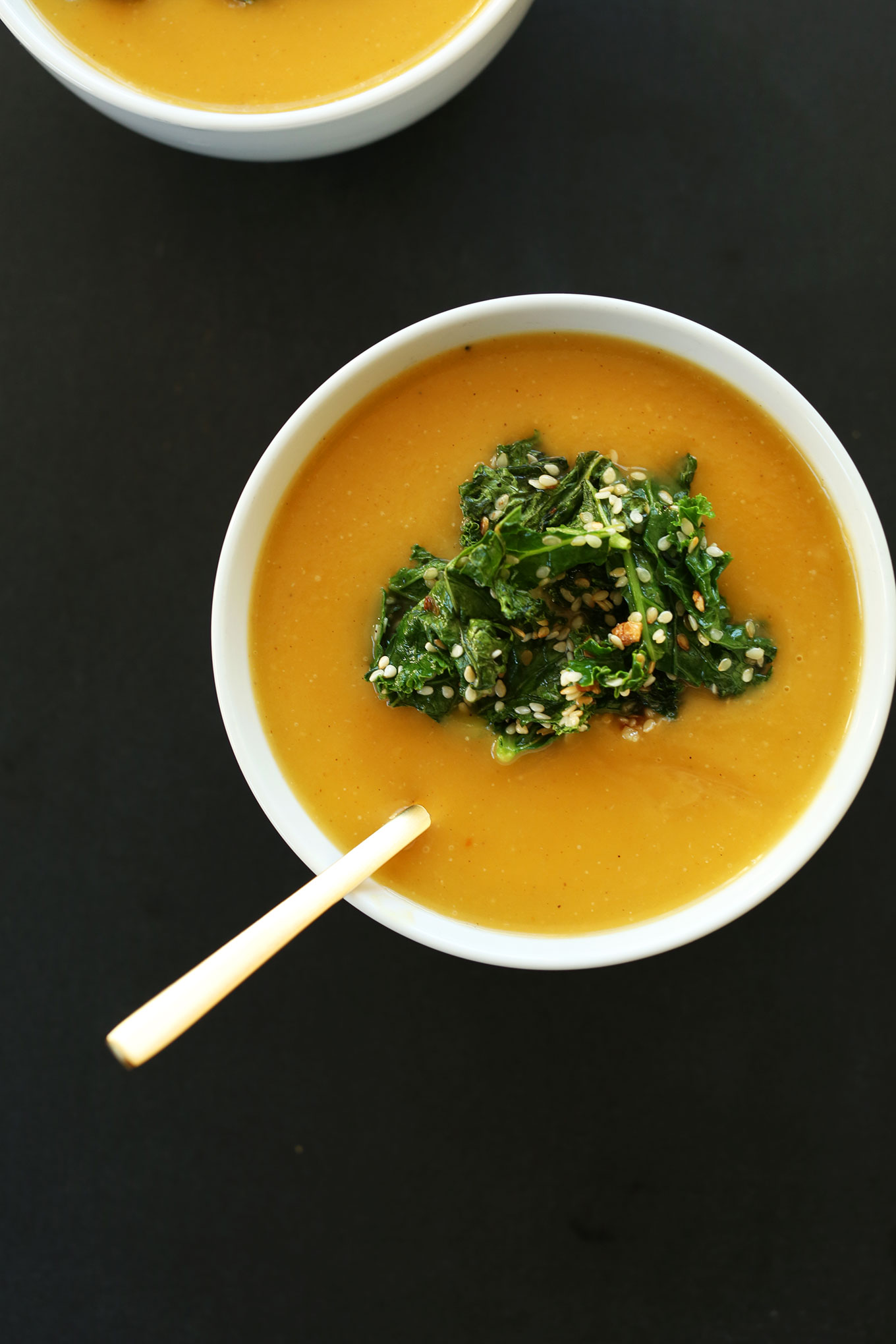 Bowl of savory homemade pumpkin soup with sesame kale