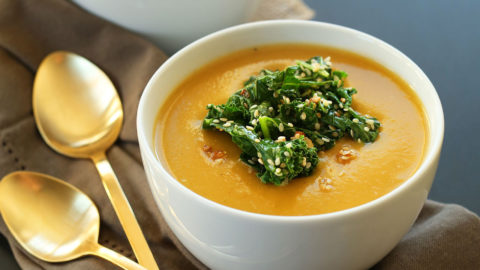 Bowls of Pumpkin Soup with Sesame Kale topping
