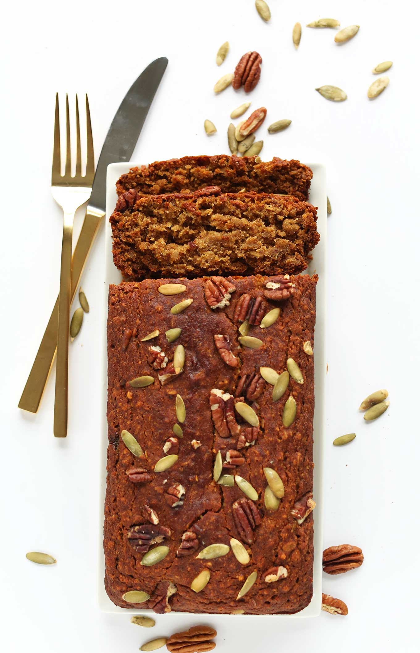 Partially sliced loaf of the best Vegan Gluten-Free Pumpkin Bread