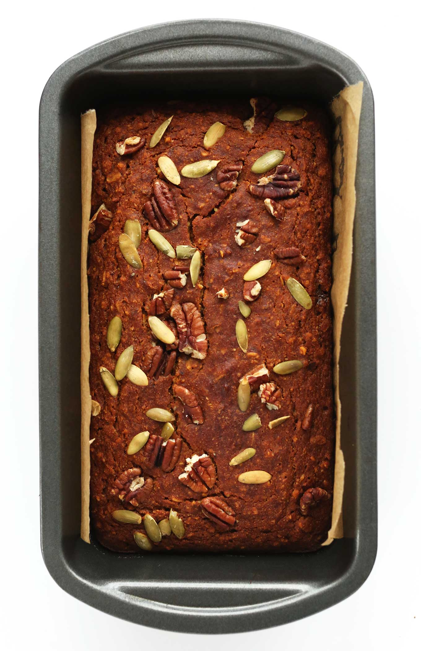 Parchment-lined baking pan filled with Vegan Gluten-Free Pumpkin Bread