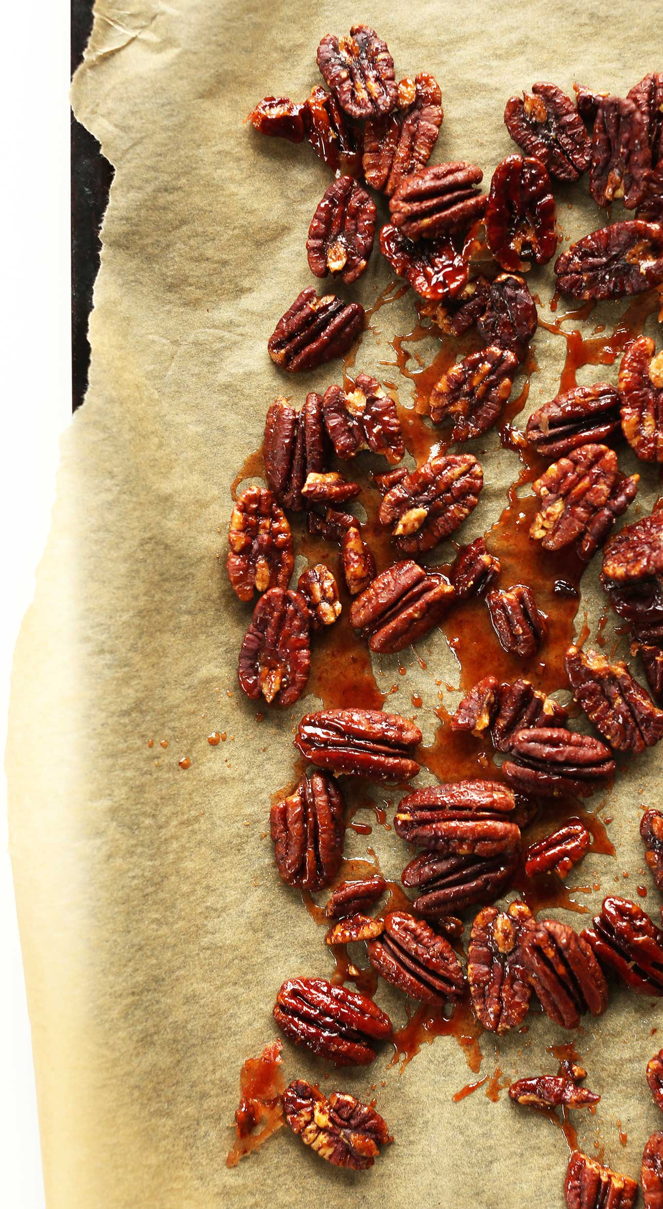Parchment-lined baking sheet with Vegan Maple Roasted Pecans