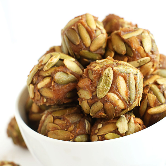 Bowl of Vegan Pumpkin Caramels rolled in pumpkin seeds