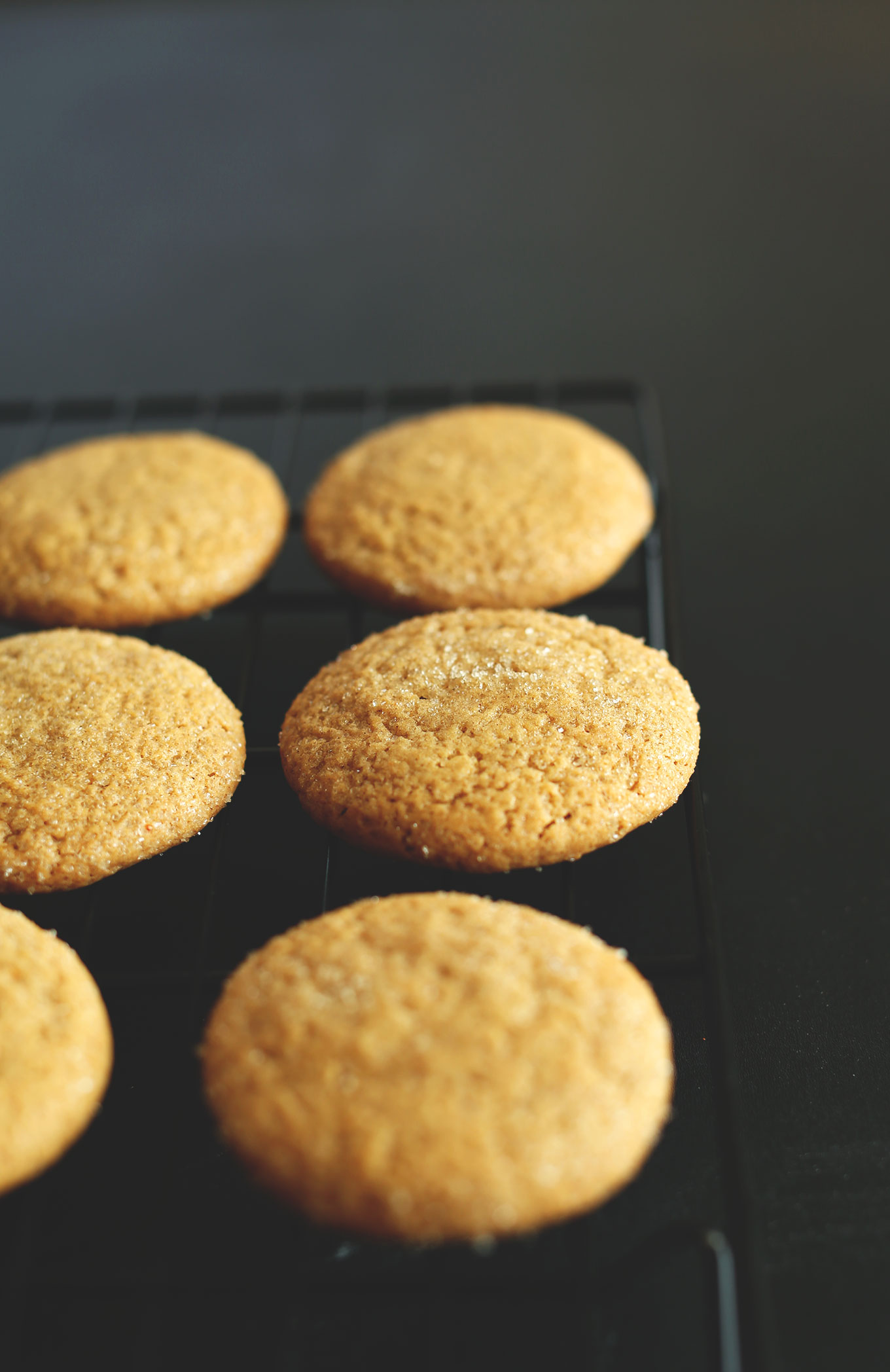 Freshly baked Vegan Pumpkin Sugar Cookies resting on a cooling rack