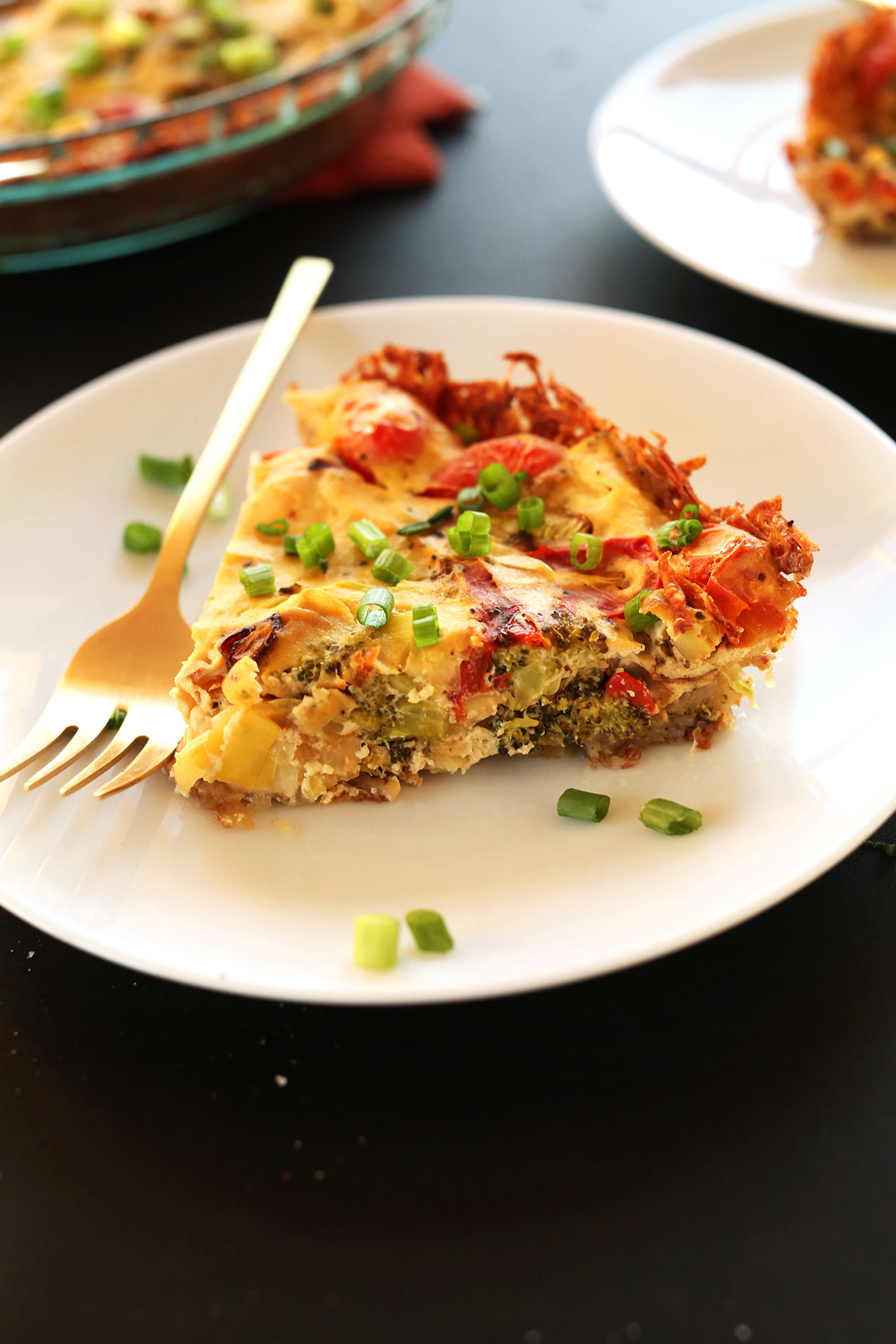Slice of Tofu Quiche for a filling gluten-free vegan breakfast