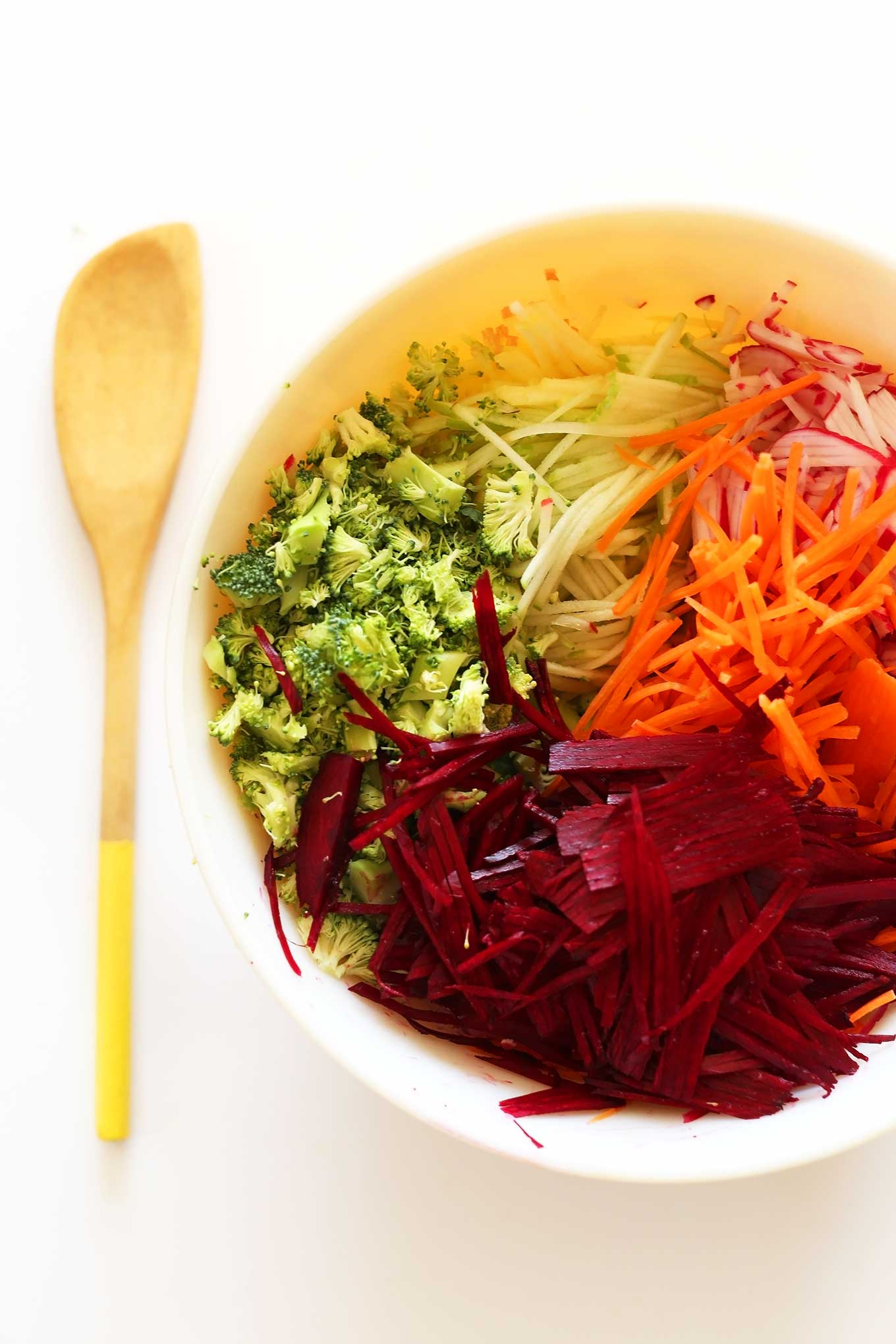 Freshly sliced vegetables in a bowl for our healthy fall slaw