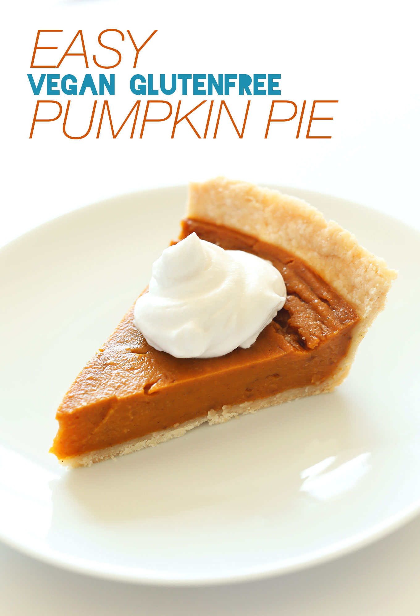 Slice of Vegan Gluten-Free Pumpkin Pie topped with coconut whipped cream