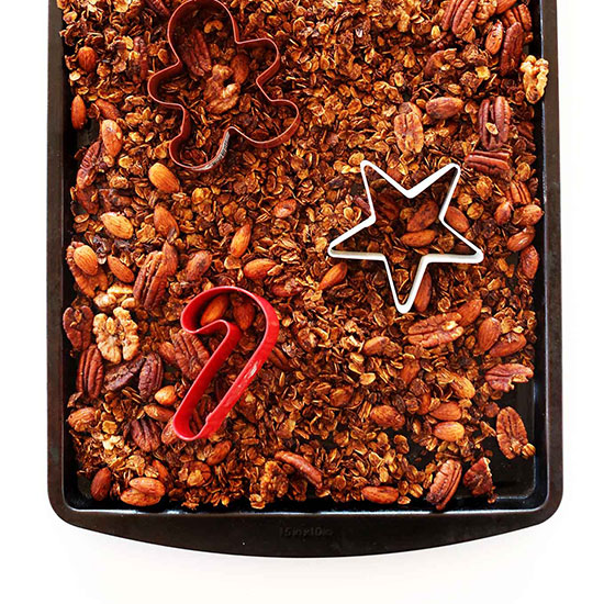Tray of Gingerbread Granola with Christmas cookie cutters on it