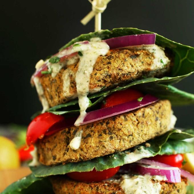 Stack of gluten-free vegan falafel burgers in collard wraps