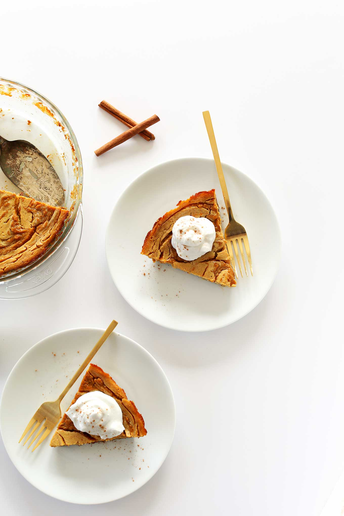 SERIOUSLY amazing Vegan Pumpkin Swirl Cheesecake with Graham Cracker Crust! #vegan #pumpkin #minimalistbaker