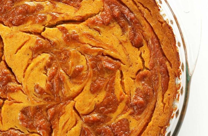 Pie pan filled with simple Vegan Pumpkin Swirl Cheesecake for Thanksgiving dessert