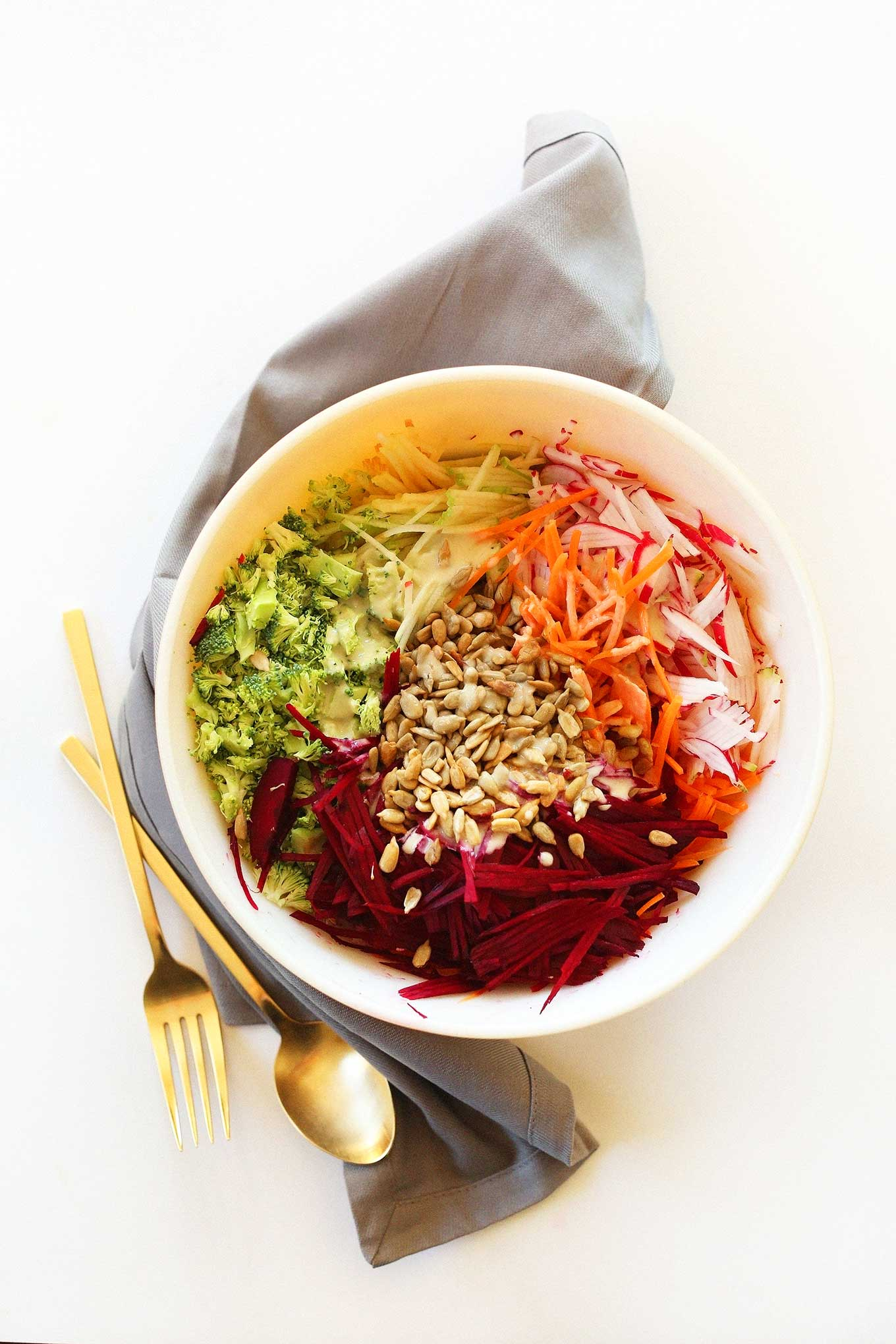 Big bowl of our healthy fall slaw topped with sunflower seeds