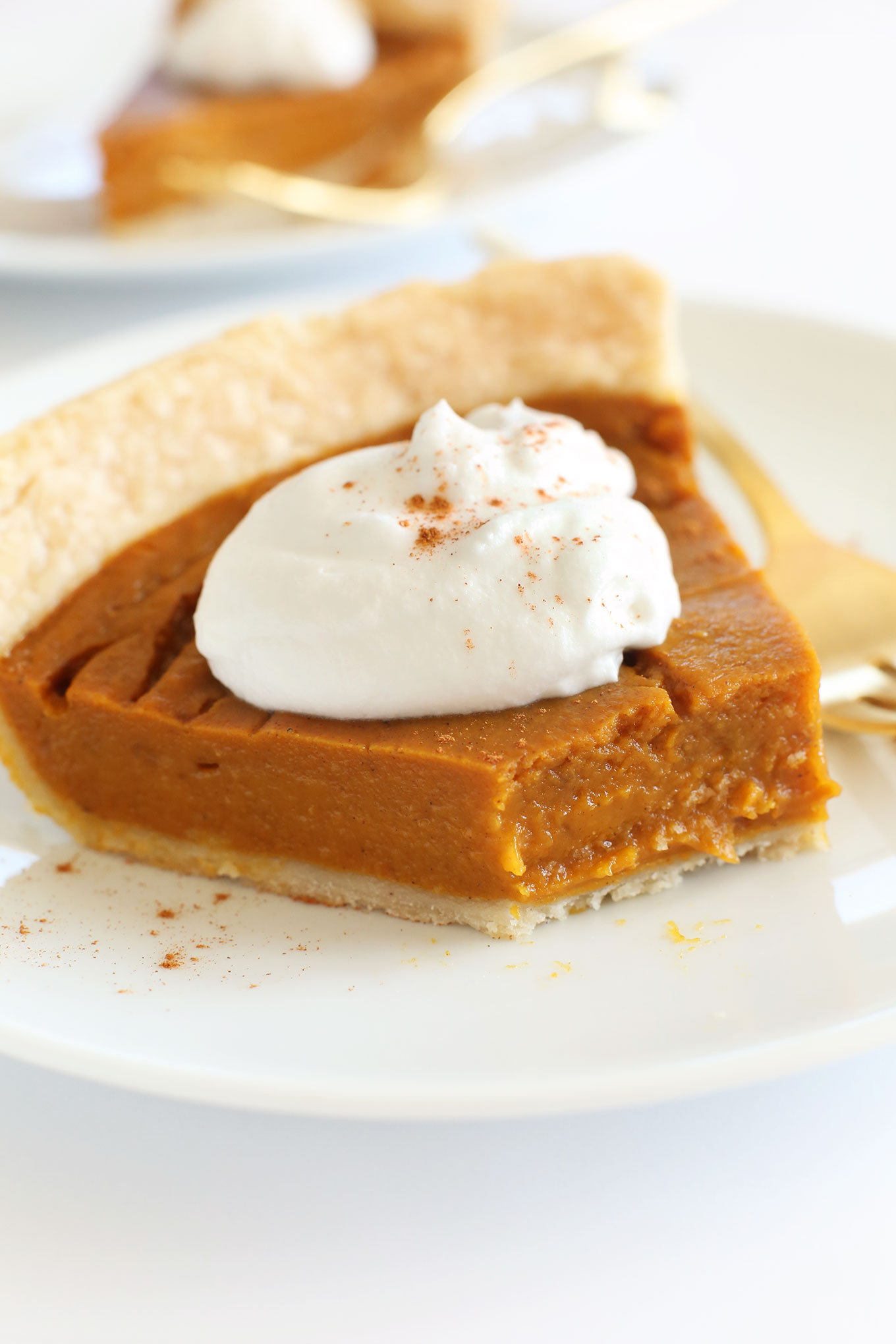 Partially eaten slice of delicious vegan gluten-free pumpkin pie