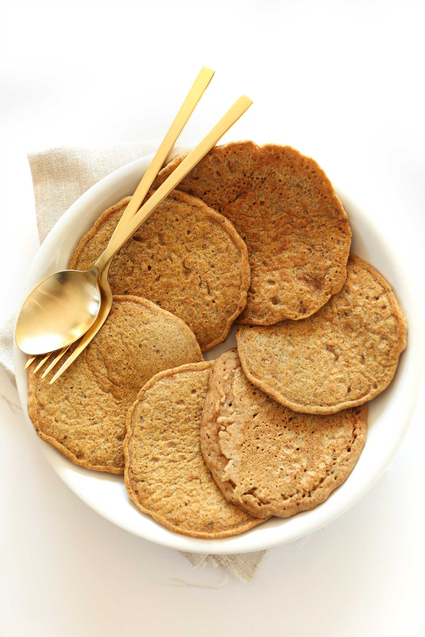 Plate of Whole Grain, Healthy Pancakes for a weekend vegan breakfast