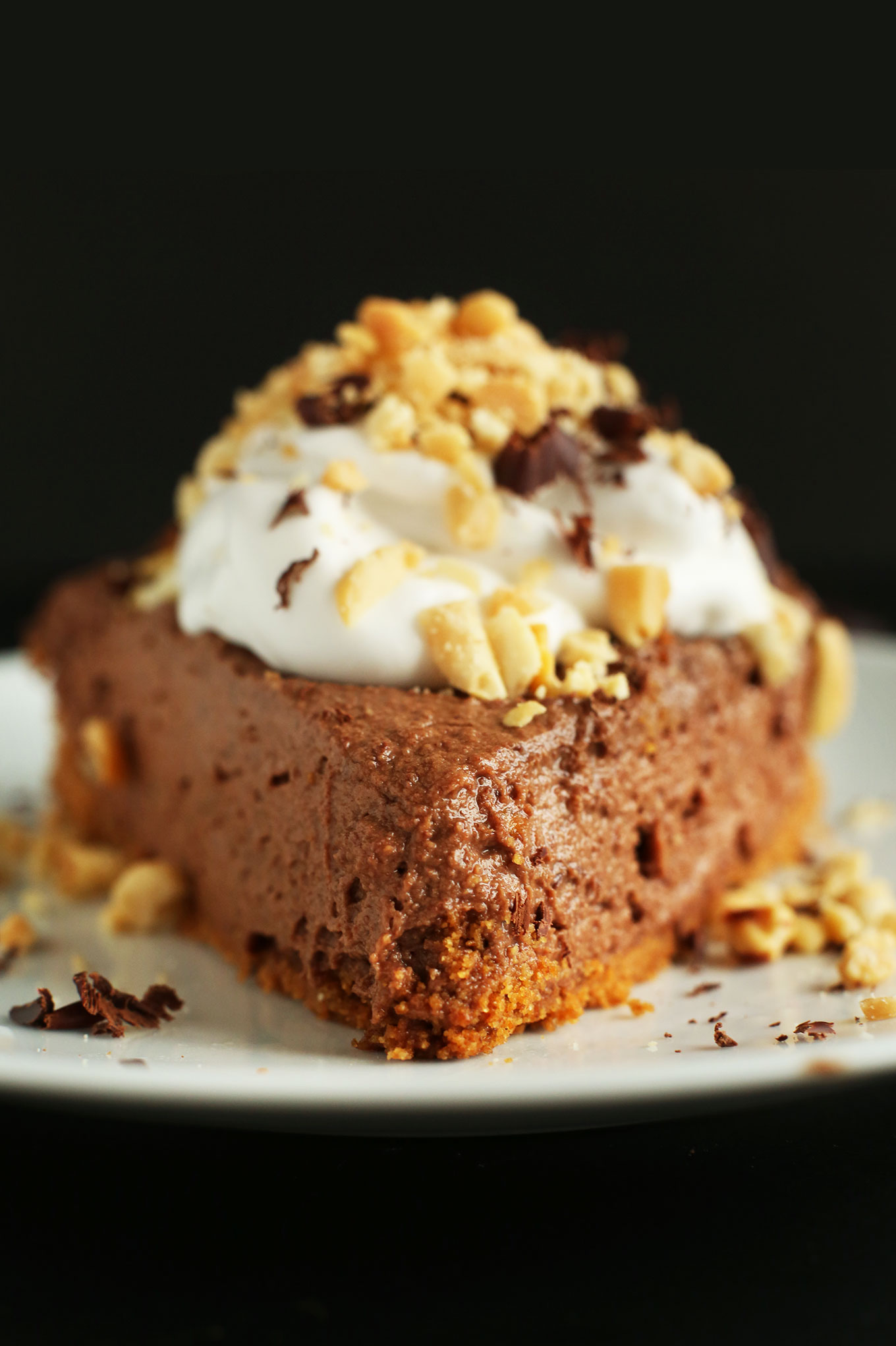 Close up shot of a slice of our creamy Vegan Chocolate PB Mousse Pie