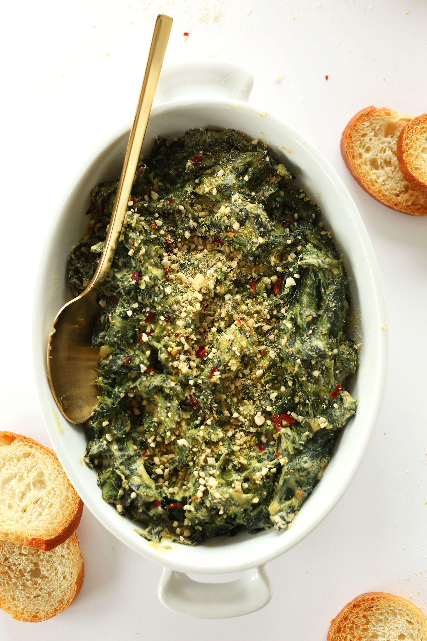 Ceramic dish filled with our Creamy vegan Kale and Spinach Dip