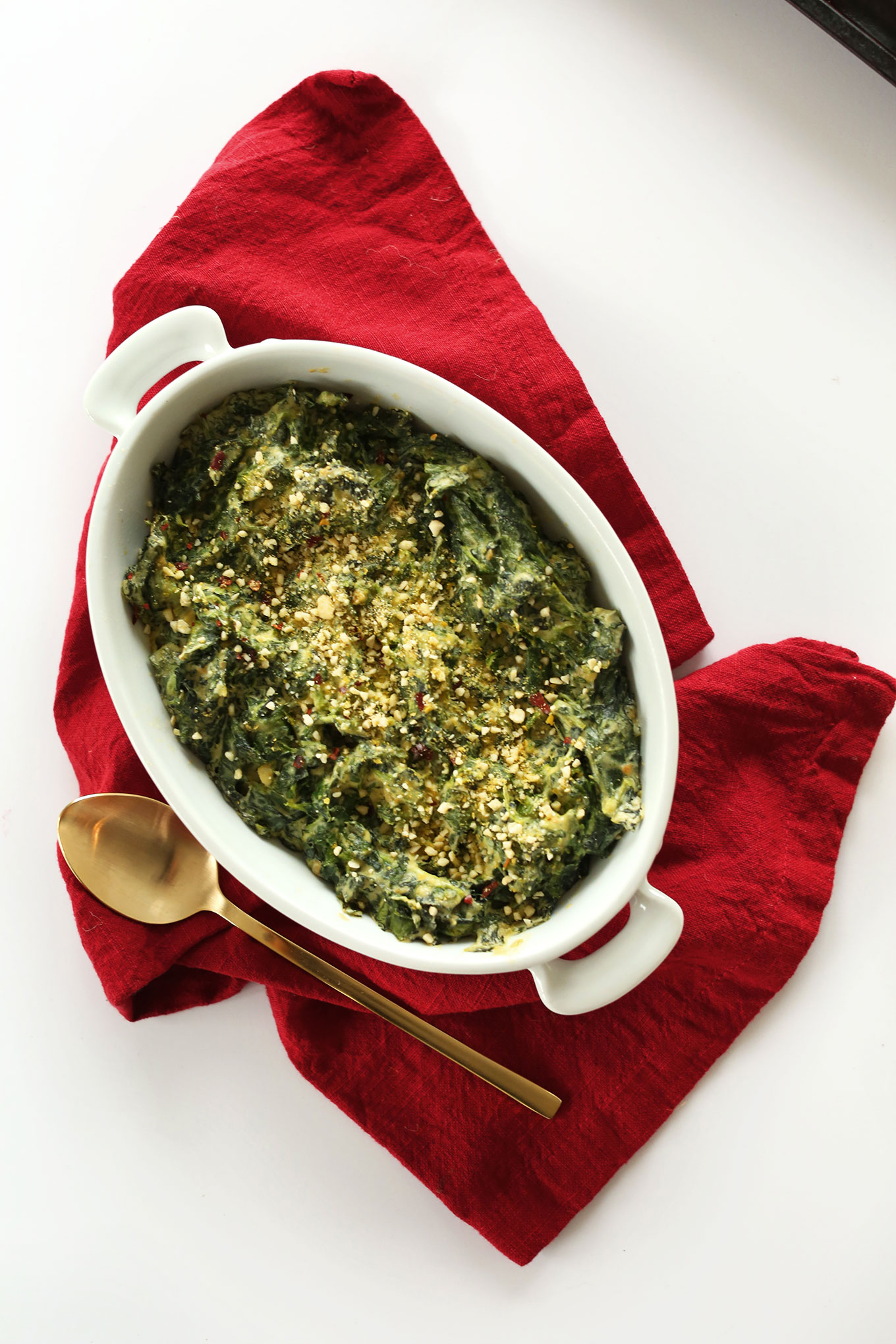 Ceramic dish filled with our fast and healthy Kale and Spinach Dip