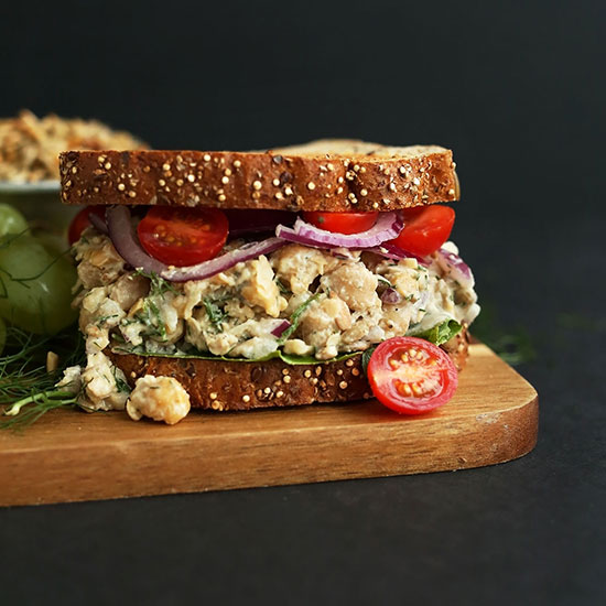 Chickpea Sunflower Sandwich on a cutting board