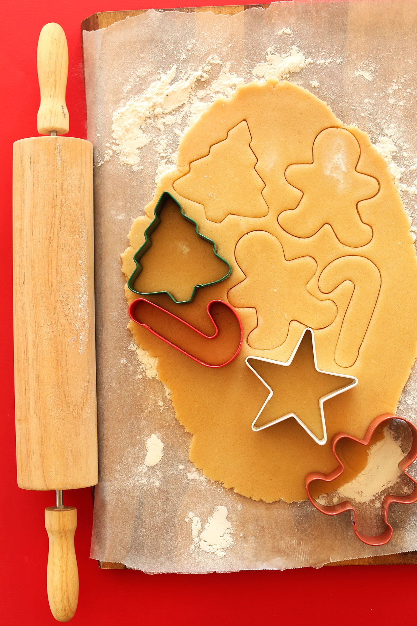 Using cookie cutters to cut out perfect Vegan Sugar Cookies
