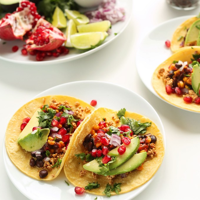 Plates of easy vegan breakfast tacos made with fresh fruit and veggies