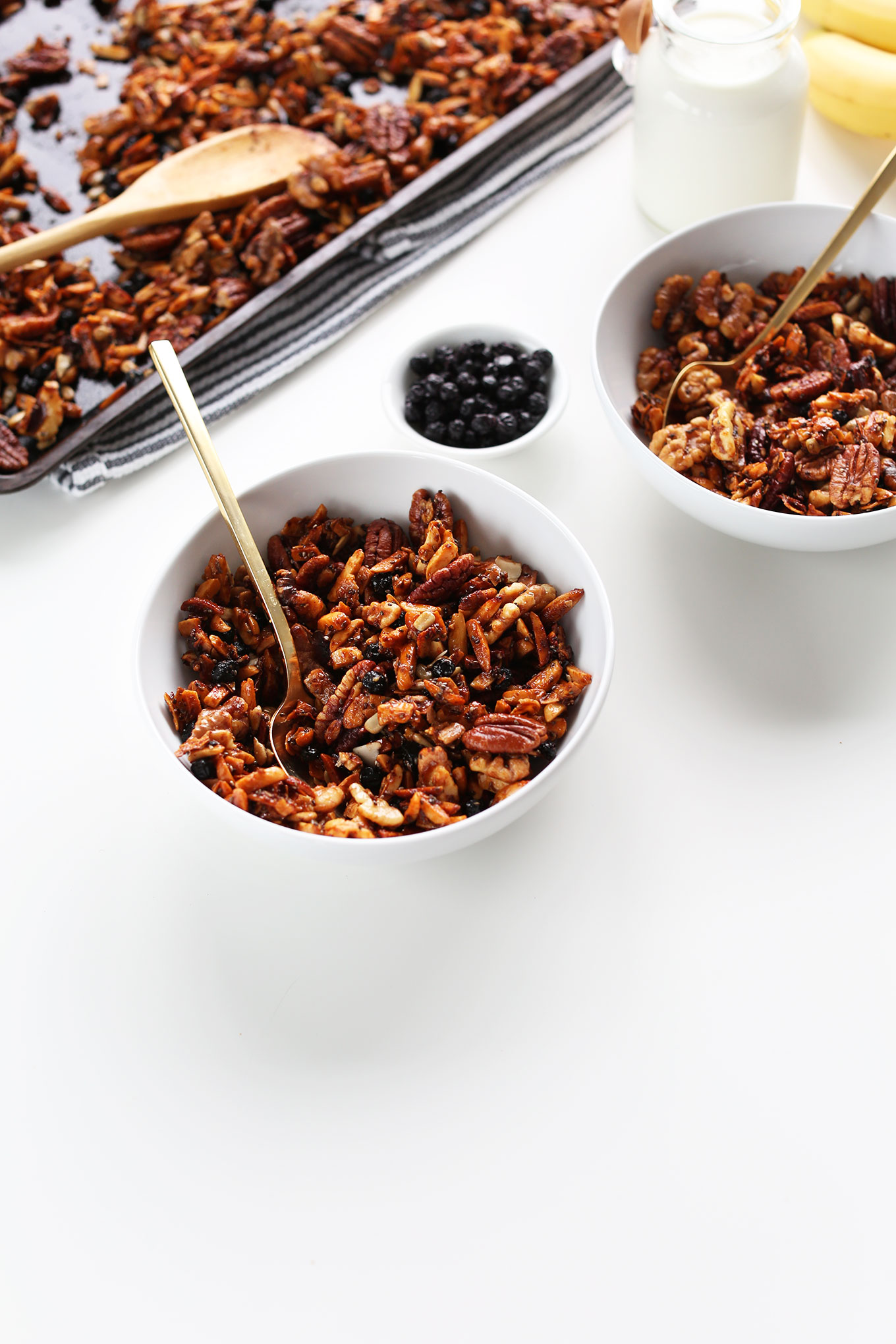 Bowls of our amazing vegan Grain-Free Granola recipe with dried blueberries
