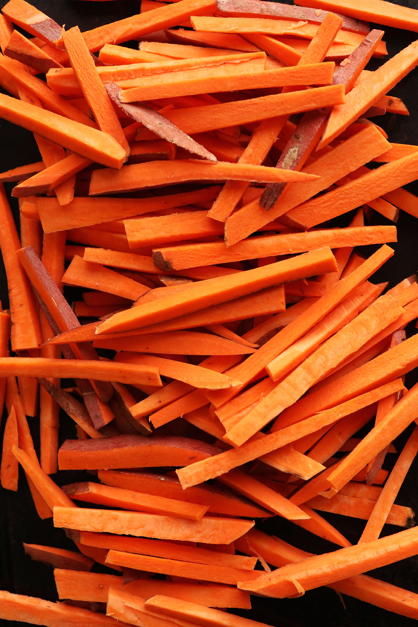 Sliced sweet potatoes for making perfectly baked Sweet Potato Fries