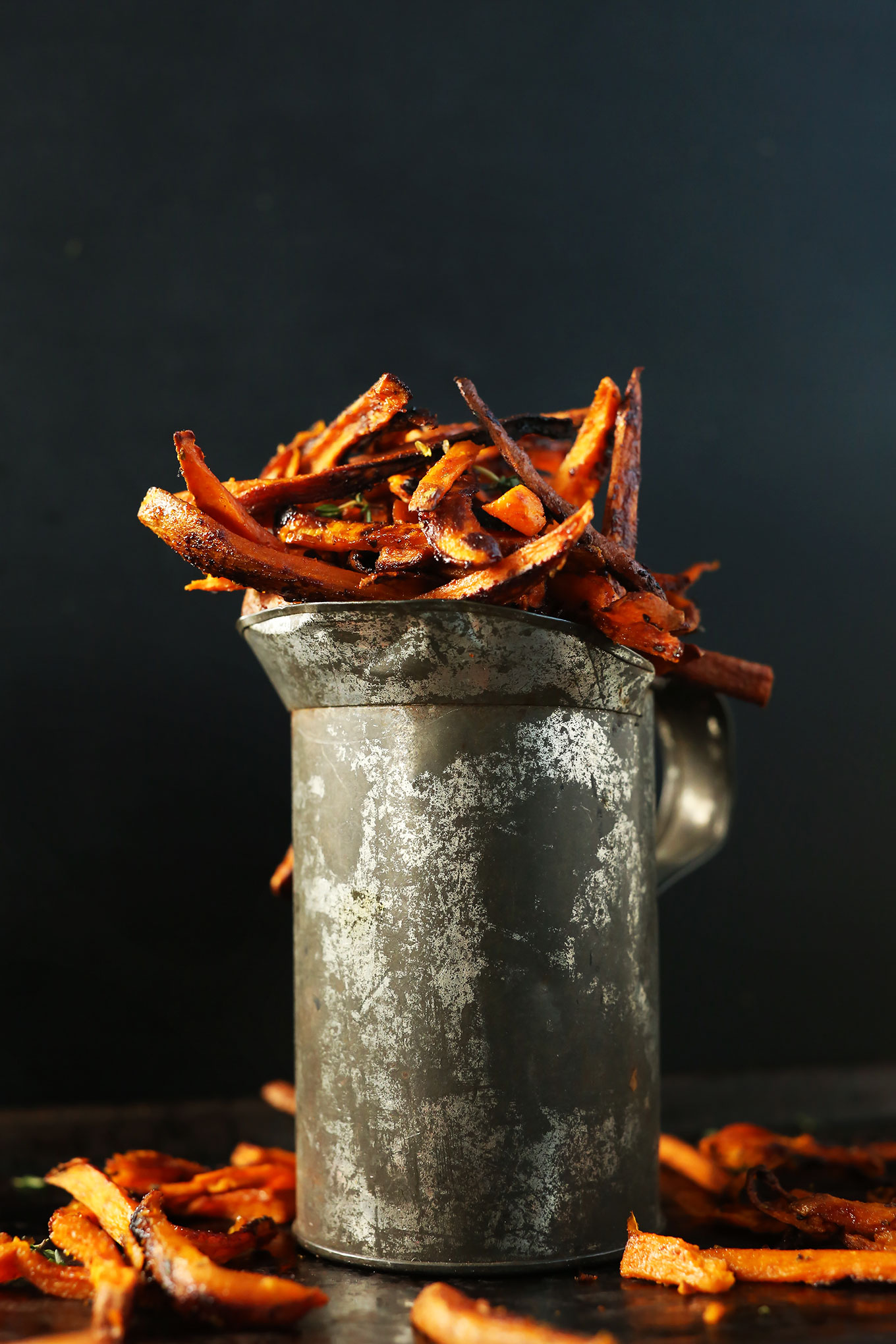 Metal pitcher filled with homemade Cajun Sweet Potato Fries