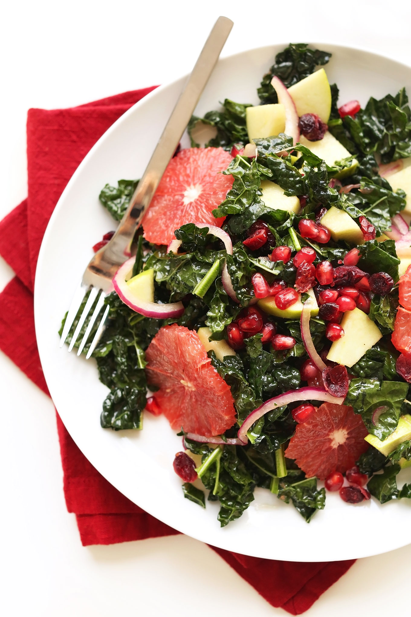 Plate of Citrus Kale Salad made with a tangy Red Wine Vinaigrette
