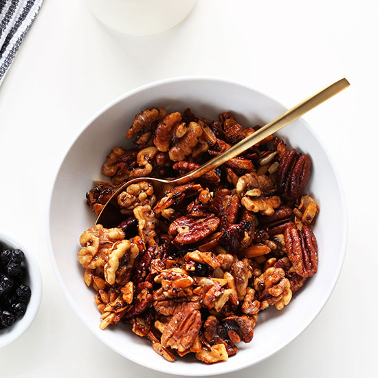 Gold spoon in a bowl of our Simple Grain-Free Granola recipe