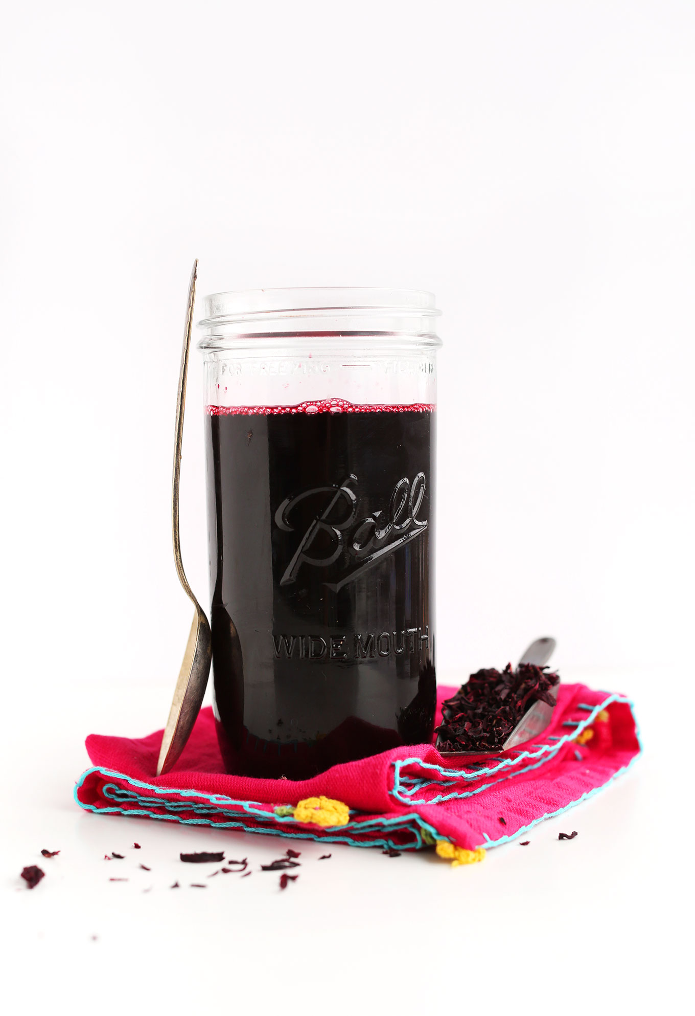 Glass jar of Hibiscus Tea Concentrate
