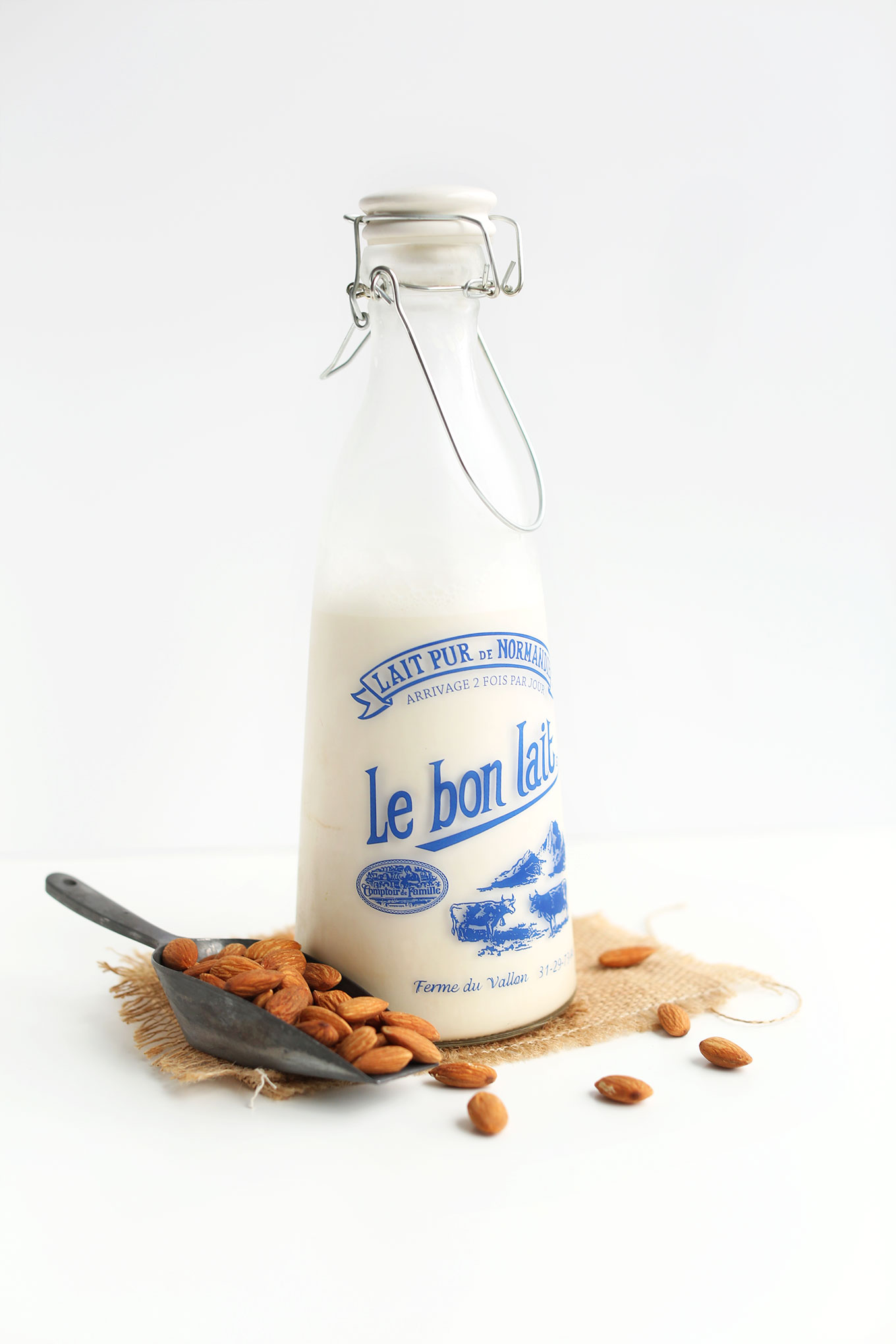 Old-fashioned milk jug filled with homemade almond milk