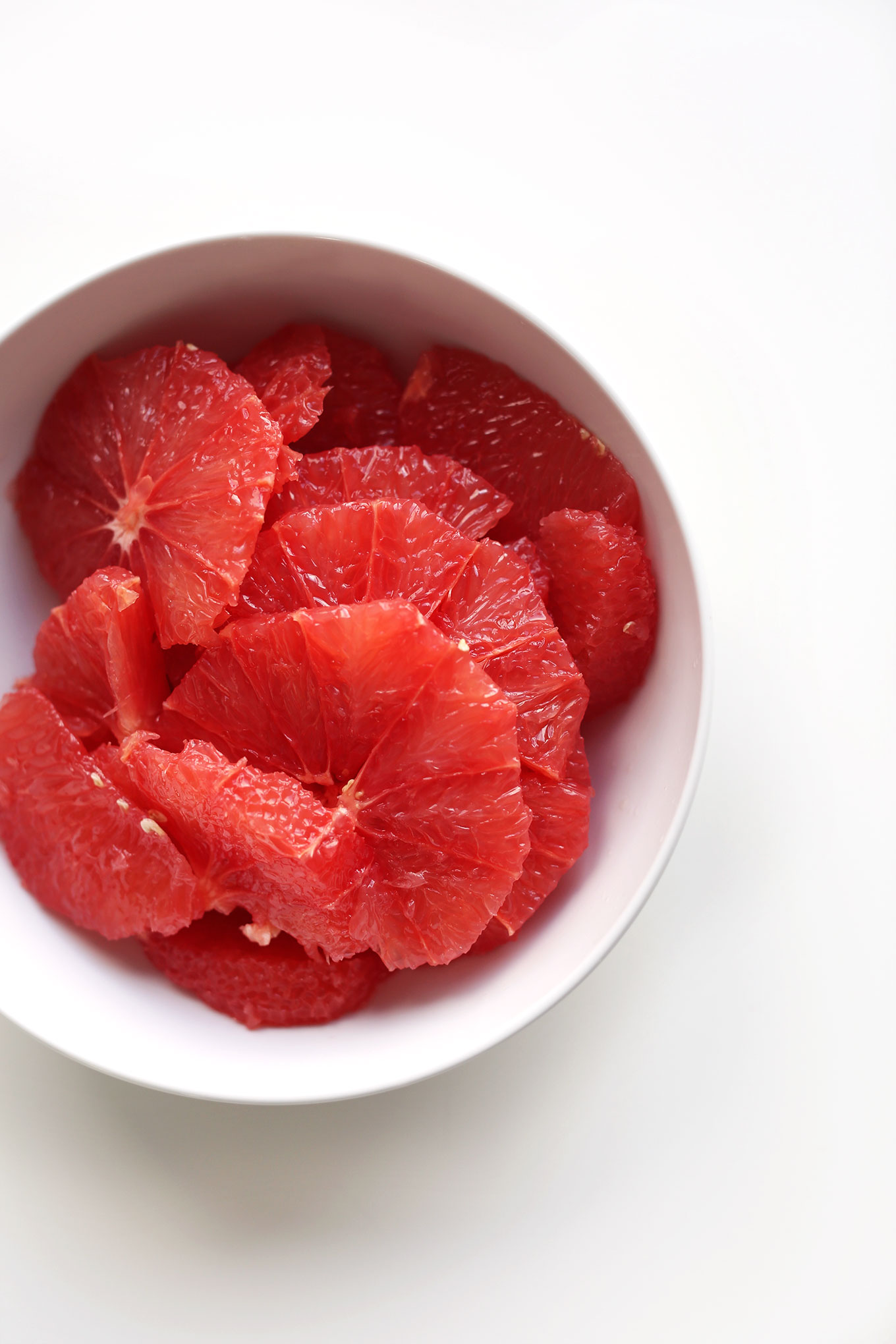 Bowl of fresh grapefruit slices for a Kale Citrus Salad Recipe