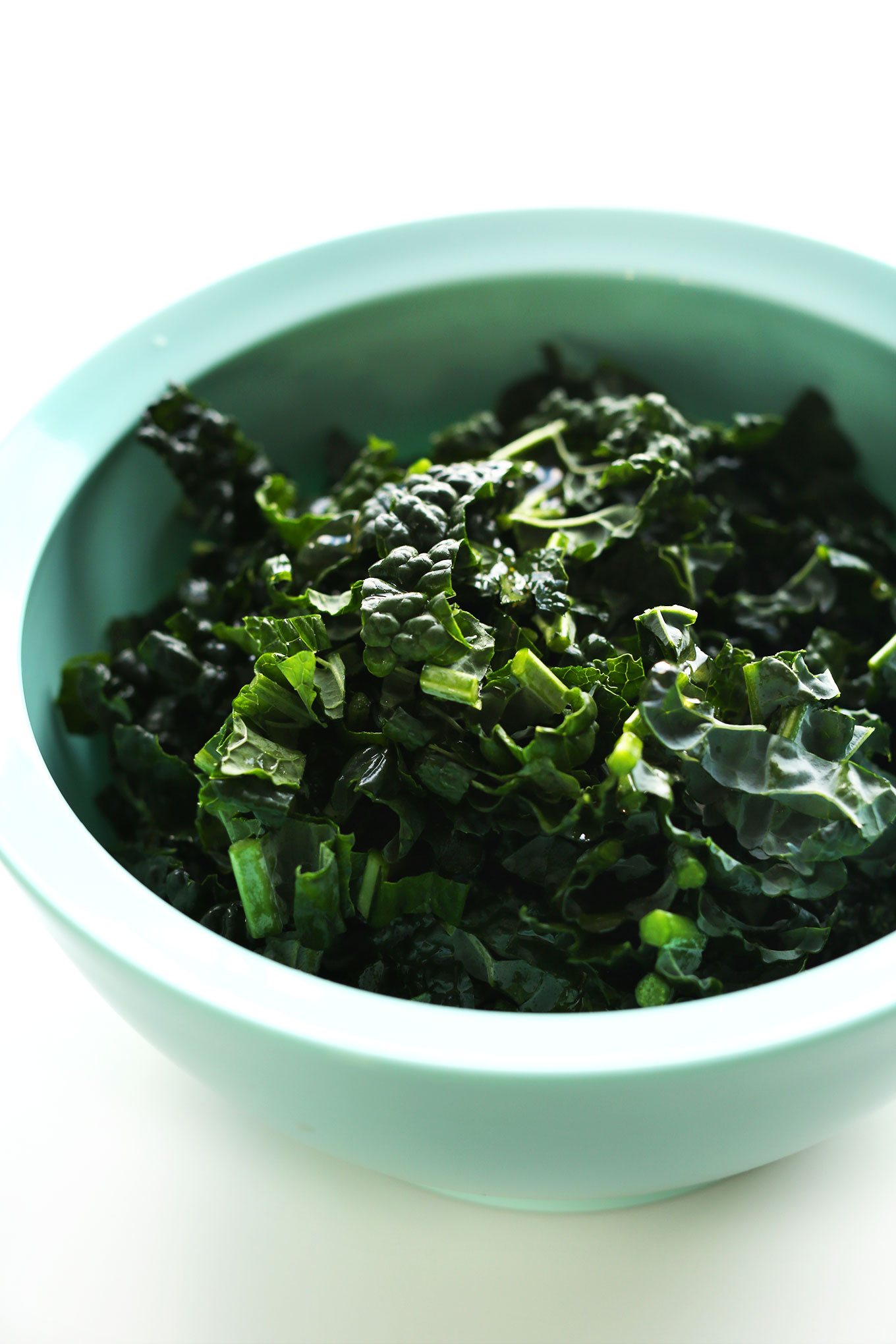 Mixing bowl filled with fresh kale