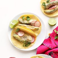 Platse of Panko Baked Avocado Tacos with sliced radishes, limes, and cilantro