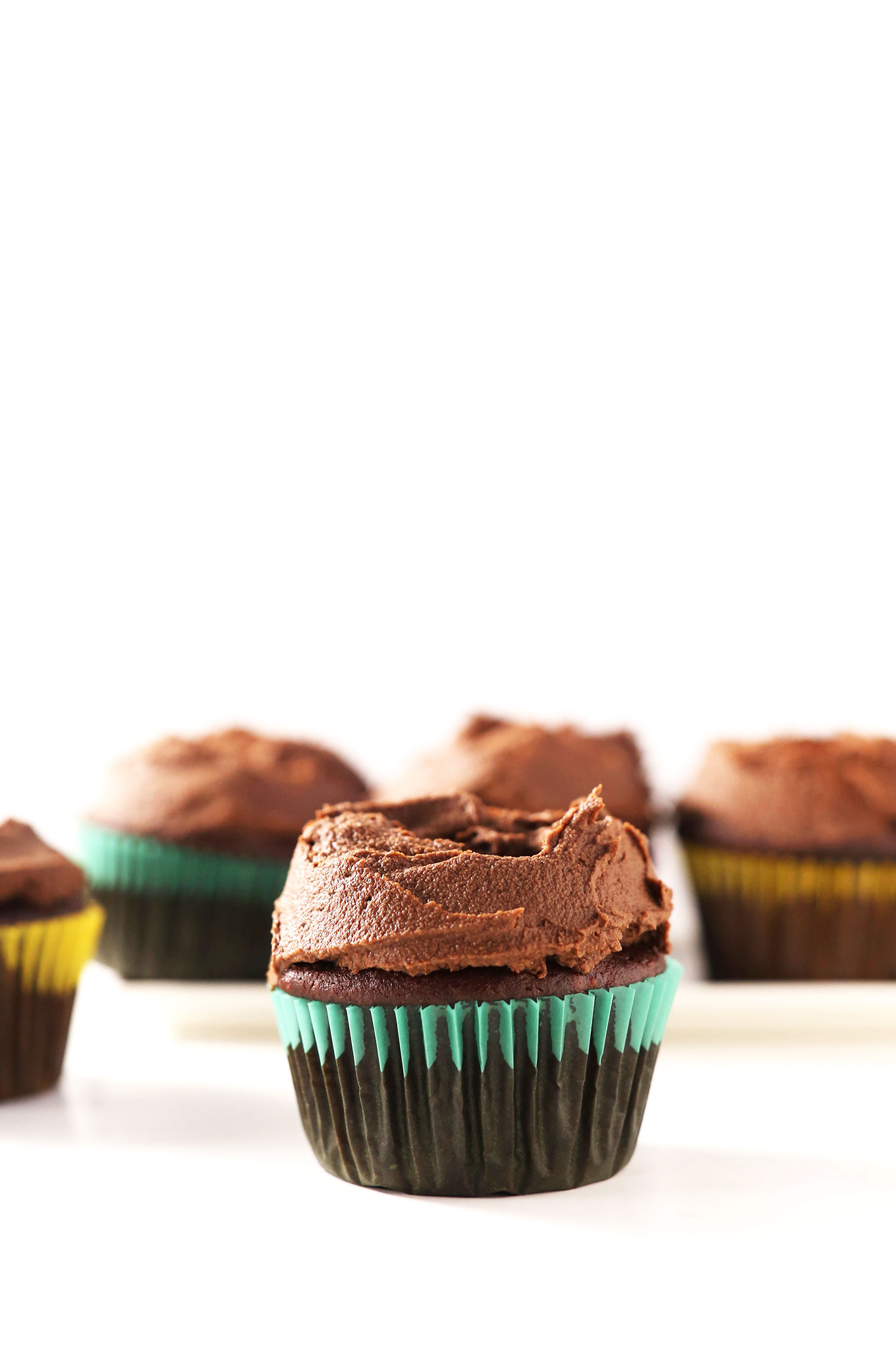 Close up shot of a chocolate cupcake topped with Vegan Chocolate Ganache Frosting